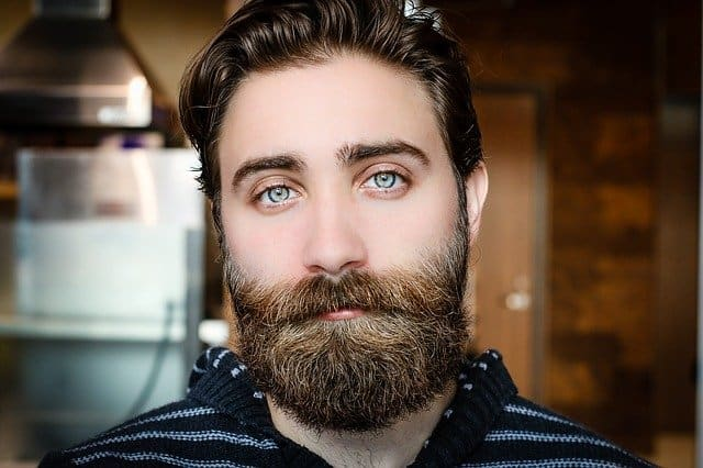 A close up of a man with a beard looking at the camera