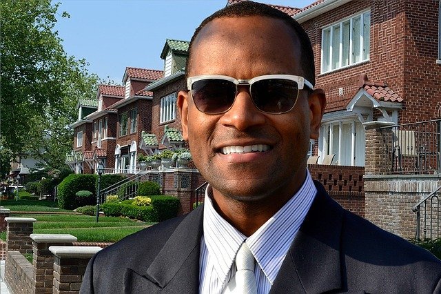 A man wearing sunglasses posing for the camera