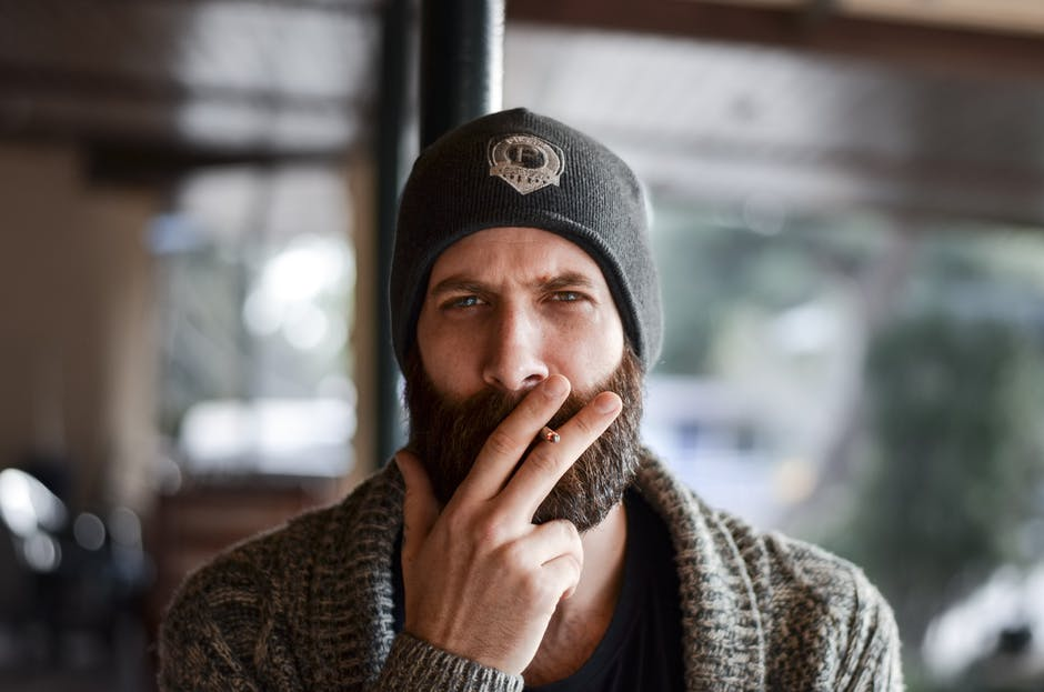 A man wearing a hat talking on a cell phone