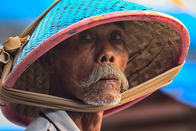 A close up of a person wearing a hat